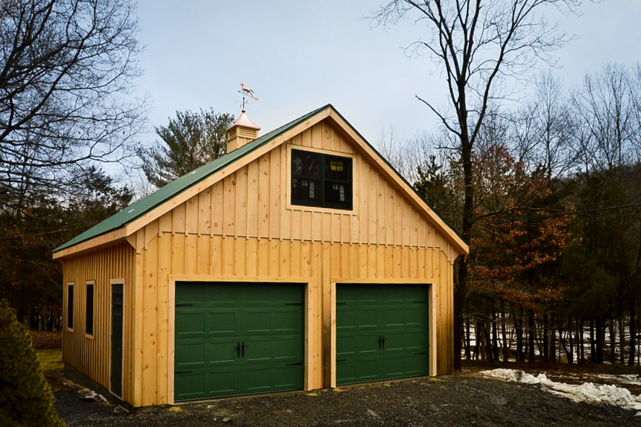 wooden two story multiple car garages