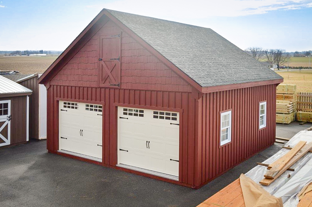 two story multiple car garages with a loft