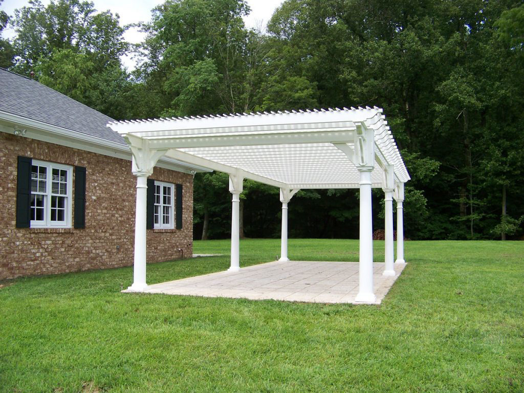 white custom pergola in the backyard
