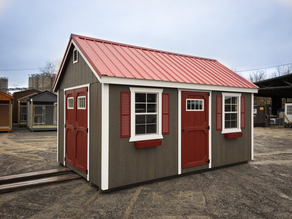 backyard storage shed with windows