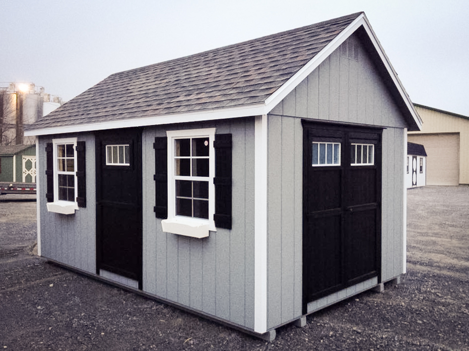 backyard storage shed with shingles