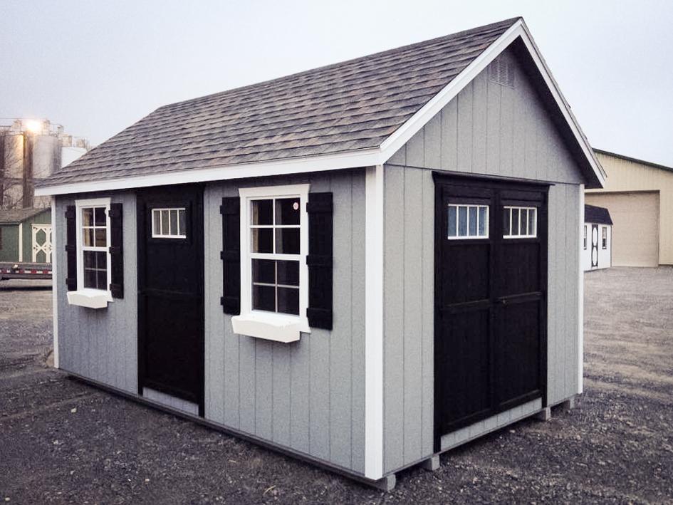 backyard storage shed with shingles